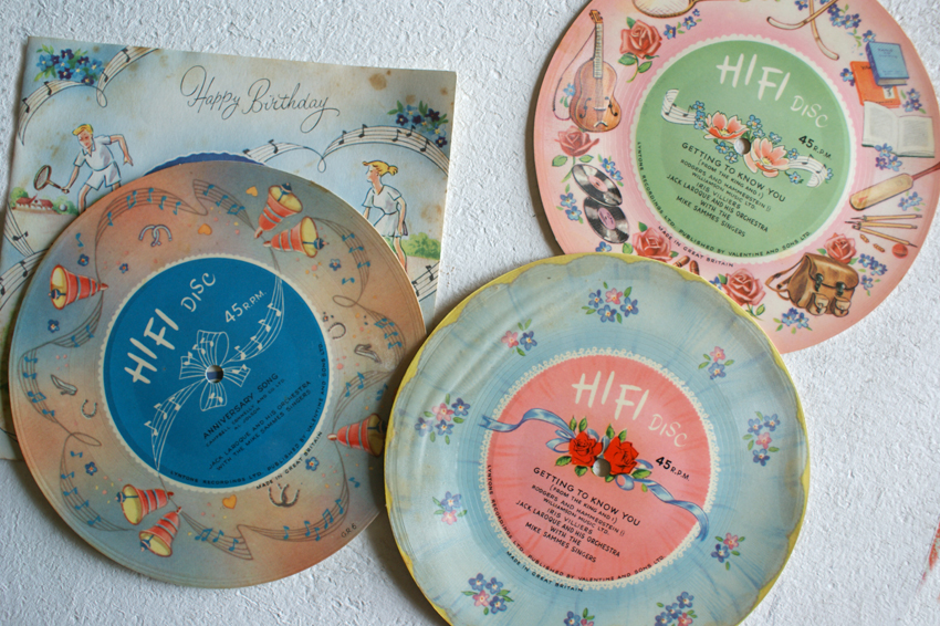 "Some ""birthday card"" flexi discs made by Lyntone. The sound medium itself is a clear plastic film, which is then laminated onto printed card."