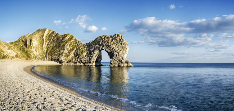 Durdle Door on Dorset's Jurassic Coast is the result of coastal erosion that weakens fractures in the limestone cliffs.