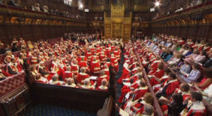 The assembled lords await the arrival of the Queen and the plebes from the House of Commons.