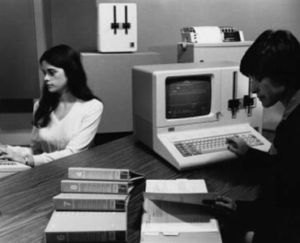 An archive photo from IBM showing the System/23 Datamaster, and presumably some university students.