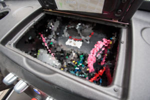 The computer inside the dashboard. Sadly a PR person took me aside afterwards and threatened bodily harm unless I pixelated this image.