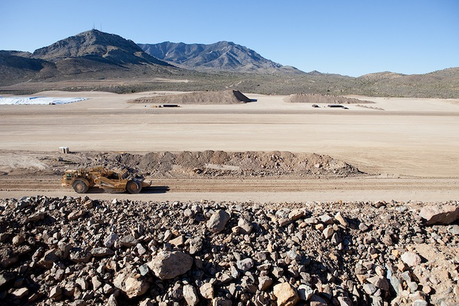 With waste water eliminated, a sludge of unwanted residues will be left behind and gradually piled in this 90-acre pit at the base of Clark Mountain.