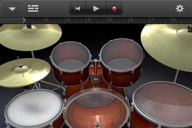 Just tap to play drums. The tighter spacing makes tapping out complex patterns a little more difficult, but it can be done.