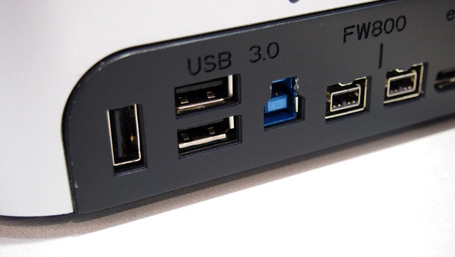 This vertical USB 3.0 port (left) can output up to 2A (or 10W total) to charge high-power devices like the iPad.