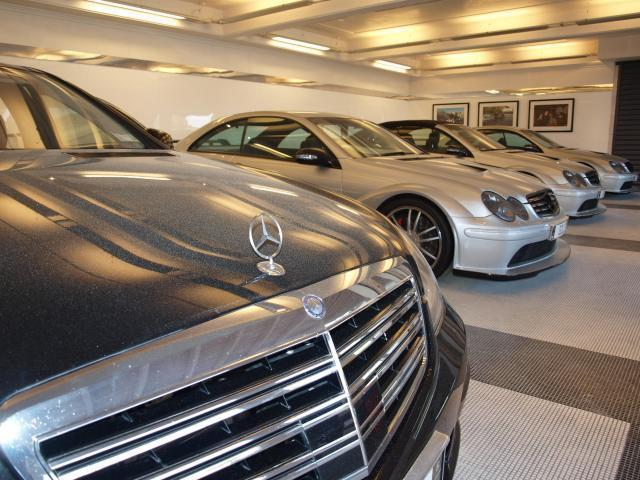Some of Kim Dotcom's cars in his estate's garage before they were seized by police