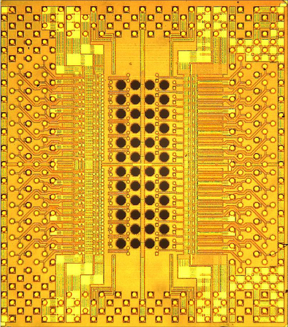 Photomicrograph of Holey Optochip, with 48 holes allowing optical access through the back of the chip to receiver and transmitter channels.