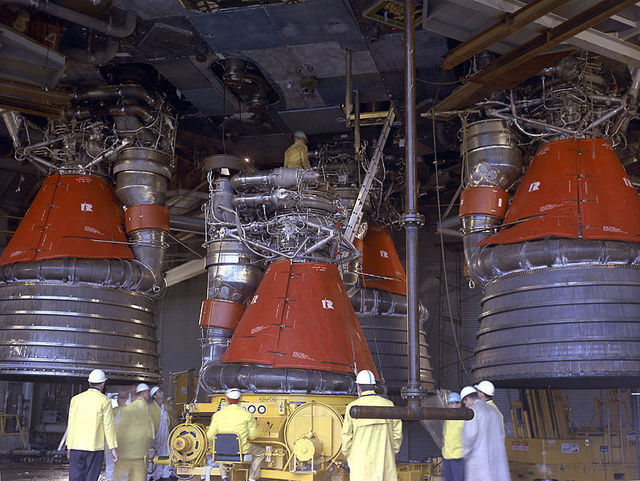 A close-up of the engines in question, with some NASA employees for scale.