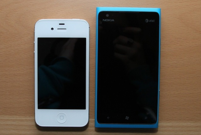 An iPhone 4S next to the Lumia 900